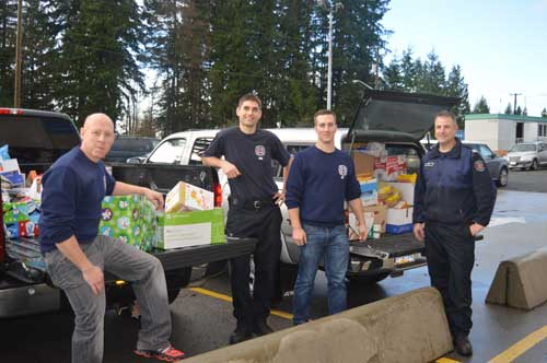 Coquitlam Firefighters pick up food donations for SHARE food bank