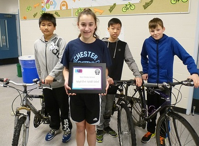 Maple Creek Middle HUB bike award - courtesy TC News.jpg